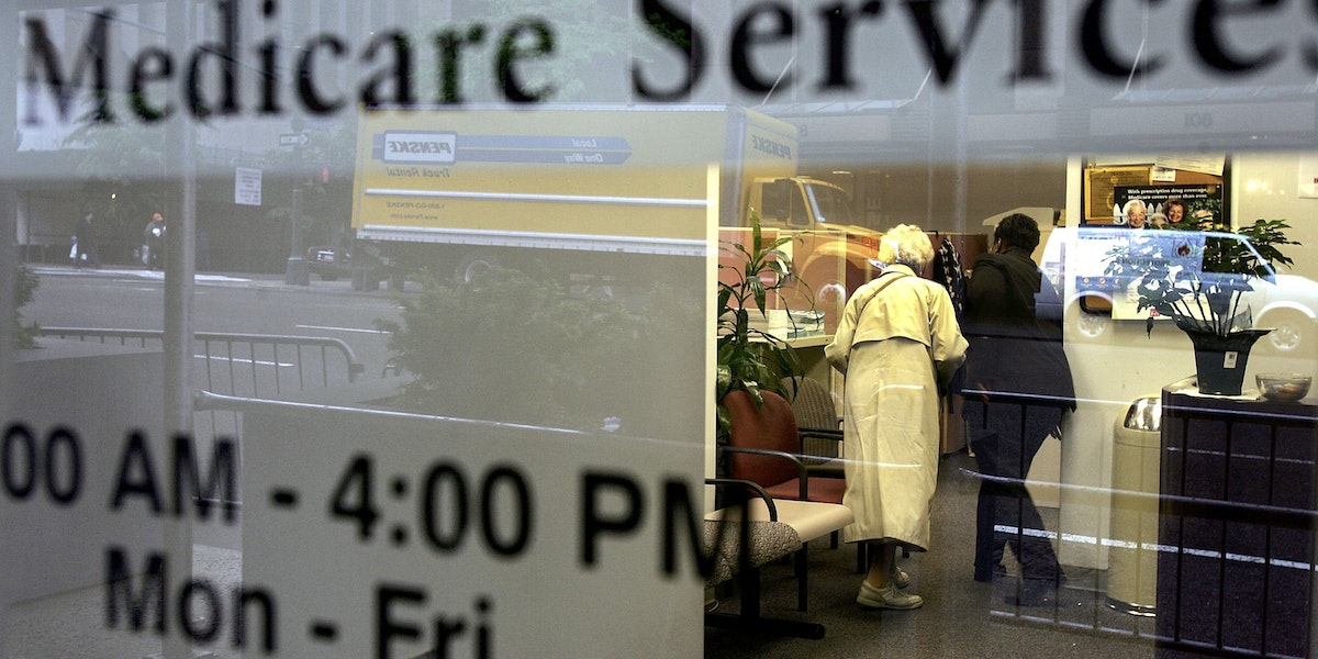 NEW YORK - MAY 15:  Two people walk inside a Medicare Services office on the last day for enrollment in the Medicare Part D program May 15, 2006 in New York City. According to official reports, approximately thirty seven million Americans, as of last week, had signed up for Medicare Part D, leaving an estimated seven million eligible seniors without drug coverage as they have yet to enroll in the drug plan.  (Photo by Spencer Platt/Getty Images)