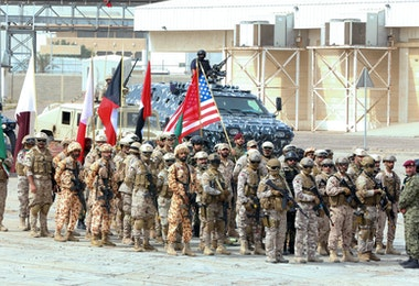 Soldiers from the United States, Kuwait, and other Gulf Cooperation Council (GCC) countries participate in the concluding drill of the wide-scale Eagle Resolve 2017 military exercise at Shuwaikh Port, west of Kuwait City on April 6, 2017. About 1,000 US military personnel supported the month-long exercise which included a series of tactical demonstrations of land, maritime and air forces from several nations. / AFP PHOTO / Yasser Al-Zayyat        (Photo credit should read YASSER AL-ZAYYAT/AFP/Getty Images)