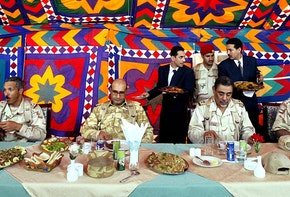 SALMI, KUWAIT - MARCH 25:  Members of the Peninsula Shield force eat lunch at a security station 25 miles from the Kuwait-Iraq border March 25, 2003 in Salmi, Kuwait. The 10,000 man unit combines forces from member states of the Gulf Cooperation Council (GCC)- Saudi Arabia, United Arab Emirates, Oman, Bahrain, Qatar and Kuwait in an effort to help defend the joint border of Saudi Arabia, Kuwait and Iraq.  (Photo by Mario Tama/Getty Images)