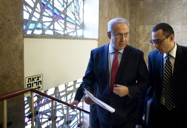 JERUSALEM, ISRAEL - NOVEMBER 14:  (ISRAEL OUT) Israeli Prime Minister Benjamin Netanyahu (L) walks up stairs to his Jerusalem offices for the weekly cabinet meeting on November 14, 2010 in Jerusalem, Israel. Netanyahu will encourage his cabinet to cease construction in the West Bank and will negotiate receiving three billion dollars worth in security incentives in return for signing a peace agreement with the Palestinians.  (Photo by Uriel Sinai/Getty Images)
