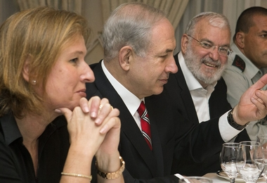 Tzipi Livni, Israel's chief negotiator with the Palestinians (L) sits next to Israel's Prime Minister Benjamin Netanyahu, with Yaakov Amidror, National Security Advisor to the Prime Minister, and Military Secretary Major General Eyal Zamir, as Netanyahu meets with U.S. Secretary of State John Kerry (unseen) in Jerusalem on June 29, 2013. Kerry kept up his frenetic Mideast diplomacy shuttling again between Palestinian and Israeli leaders in hopes of restarting peace talks.AFP PHOTO/JACQUELYN MARTIN-POOL        (Photo credit should read JACQUELYN MARTIN/AFP/Getty Images)