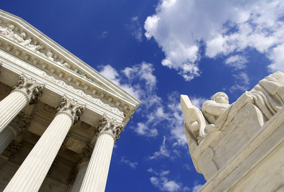 Authority of Law statue in front of the United States Supreme Court in Washington, D.C.