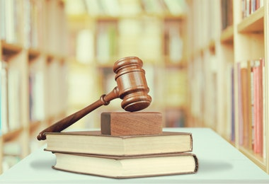 Books and wooden gavel, justice concept