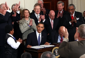 WASHINGTON - MARCH 23:  U.S. President Barack Obama is applauded after signing the Affordable Health Care for America Act during a ceremony with fellow Democrats in the East Room of the White House March 23, 2010 in Washington, DC. The historic bill was passed by the House of Representatives Sunday after a 14-month-long political battle that left the legislation without a single Republican vote. Pictured is also Rep. Sandy Levin (D-MI), U.S. Vice President Joe Biden, U.S. Speaker of the House Rep. Nancy Pelosi (D-CA), Senate Majority Leader Harry Reid (D-NV), Rep. Henry Waxman (D-CA), Rep. Charlie Rangel (D-NY), Rep. George Miller (D-CA), House Majority Leader Steny Hoyer (D-MD), Rep. John Dingell (D-MI), House Majority Whip Rep. James Clyburn (D-SC), Marcelas Owens, Rep. Patrick Kennedy (D-RI), Sen. Ted Kennedy's widow Victoria Kennedy, Health and Human Services Secretary Kathleen Sebelius.  (Photo by Win McNamee/Getty Images)