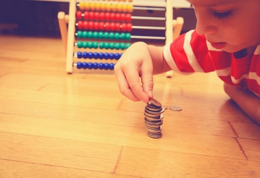 Little boy counting his savings, saving and learning money