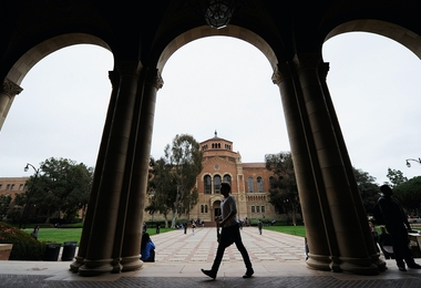 LOS ANGELES, CA - APRIL 23:  A student walks near Royce Hall on the campus of UCLA on April 23, 2012 in Los Angeles, California. According to reports, half of recent college graduates with bachelor's degrees are finding themselves underemployed or jobless.  (Photo by Kevork Djansezian/Getty Images)
