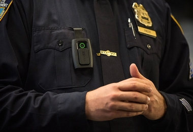NEW YORK, NY - DECEMBER 03:  New York Police Department (NYPD) Sergeant Joseph Freer demonstrates how to use and operate a body camera during a media press conference on December 3, 2014 in New York City. The NYPD is beginning a trial exploring the use of body cameras; starting Friday NYPD officers in three different precincts will begin wearing body cameras during their patrols.  (Photo by Andrew Burton/Getty Images)