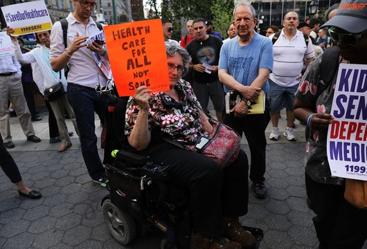 NEW YORK, NY - JUNE 28:  Jean Ryan from Disabled in Action joins others in protesting against the Senate healthcare bill on June 28, 2017 in New York City. The vote on the bill, which would make drastic cuts in medicaid among other changes, was postponed on Tuesday as Republican leadership seek to persuade fellow Republicans to vote for the plan. Currently, nine senators have said they will not support the bill, and the party can only afford to lose two for it to pass.  (Photo by Spencer Platt/Getty Images)