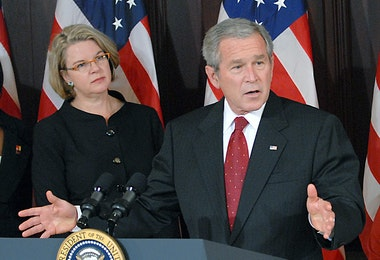 WASHINGTON  - SPETEMBER 27: U.S. President George W. Bush speaks before signing H.R. 2669, the College Cost Reduction and Access Act, as U.S. Secretary of Education Margaret Spellings listens at the White House September 27, 2007 in Washington, The act make college more affordable for low-income students by increasing funding for Federal Pell Grants by more than $11 billion.   (Photo by Ron Sachs-Pool/Getty Images)
