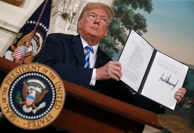 WASHINGTON, DC - MAY 08:  U.S. President Donald Trump holds up a memorandum that reinstates sanctions on Iran after he announced his decision to withdraw the United States from the 2015 Iran nuclear deal in the Diplomatic Room at the White House May 8, 2018 in Washington, DC. After two and a half years of negotiations, Iran agreed in 2015 to end its nuclear program in exchange for Western countries, including the United States, lifting decades of economic sanctions. Since then international inspectors have not found any violations of the terms by Iran.  (Photo by Chip Somodevilla/Getty Images)