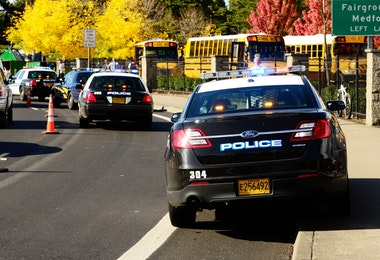 Roseburg Oregon - October 16, 2012: Police cars and school buses at an accident scene at the entrance of the High School loading zone
