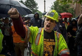 NEW YORK, NY - MAY 22: Construction workers and union members hold a rally in Columbus Circle, May 22, 2018 in New York City. On Monday, the Supreme Court delivered a 5-4 ruling stating that companies can use arbitration clauses in employee contracts to prohibit them from filing class-action lawsuits concerning workplace issues. Unions and workers' rights advocates are also awaiting an expected June ruling by the Supreme Court in the Janus v. AFSCME case, which could give government workers nationwide the choice of opting out of paying union fees even if they benefit from the union's contract negotiations.(Photo by Drew Angerer/Getty Images)