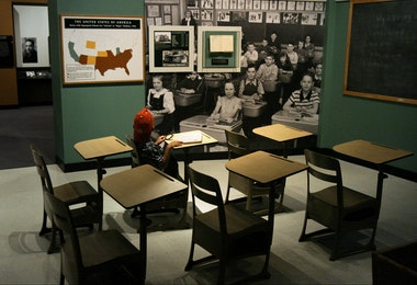 WASHINGTON - MAY 15:  Jordan Maclin, 6 of Maryland, sits in a Brown vs Board of Ed era classroom at the