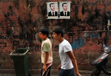 BEIRUT, LEBANON - JUNE 30: Pictures of Syrian president Bashar al-Assad are viewed along a wall in a poor, Hezbollah influenced neighborhood with a high concentration of Syrian refugees on June 30, 2013 in Beirut, Lebanon. Currently the Lebanese government officially hosts 546,000 Syrians with an estimated additional 500,000 who have not registered with the United Nations. Lebanon, a country of only 4 million people, is now home to the largest number of Syrian refugees who have fled the conflict. The situation is beginning to put a huge social and political strains on Lebanon as there is currently no end in sight to the war in Syria. (Photo by Spencer Platt/Getty Images)