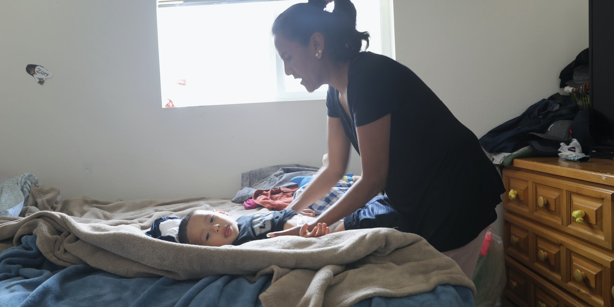 DENVER, CO - JUNE 06:  Undocumented immigrant activist Jeanette Vizuerra changes her grandson's diaper on June 6, 2017 in Denver, Colorado. Vizguerra was given a temporary stay of deportation by ICE in May after taking sanctuary in Denver churches for three months. Vizguerra, who is from Mexico, has lived in the United States for twenty  years and has three U.S.-born children. U.S. Immigration and Customs Enforcement (ICE), agents, emboldened by the leadership of President Donald Trump, have almost doubled arrests of undocumented immigrants, many of whom without criminal records, up from the previous year. The soaring number of detentions highlights a Trump campaign pledge to target the some 11 million people living as undocumented immigrants in the United States.  (Photo by John Moore/Getty Images) (Photo by John Moore/Getty Images)