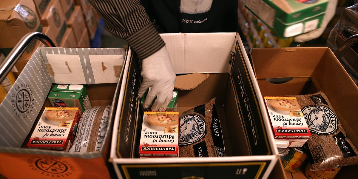 RICHMOND, CA - NOVEMBER 01:  Richmond Emergency Food Bank volunteer Abdul Olorode packs boxes with food to be handed out to needy people on November 1, 2013 in Richmond, California.  An estimated 47 million Americans will see their food stamp benefits cut starting today as temporary relief to the federal program ends with no new budget from Congress to replace it. Under the new Supplemental Nutrition and Assistance Program (SNAP), a family of four that used to receive $668 per month will see that amount cut by $36.  (Photo by Justin Sullivan/Getty Images)