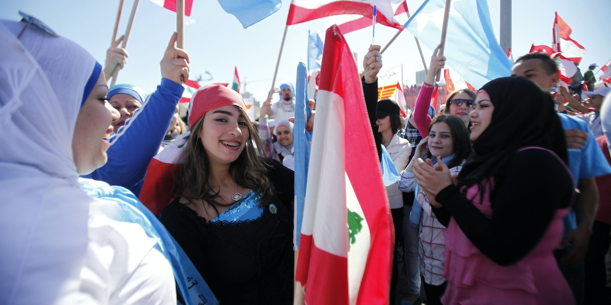 BEIRUT, LEBANON - MARCH 13:  Protesters wave Lebanese flags during a demonstration on March 13, 2011 in Beirut, Lebanon.  Tens of thousands of Lebanese opposition supporters demanded Hezbollah be disarmed as they rallied to mark the sixth anniversary of a popular uprising against Syrian troops in the country. (Photo by Salah Malkawi/ Getty Images)