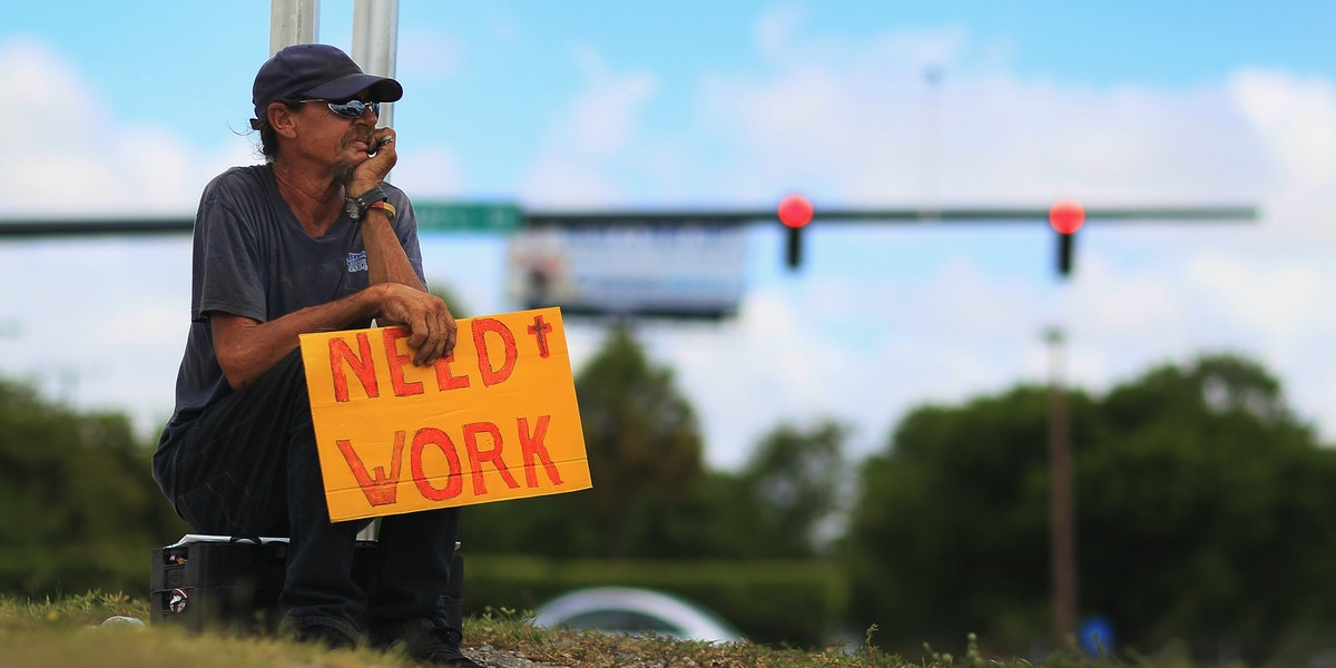 POMPANO BEACH, FL - JUNE 03:  Stephen Greene works a street corner hoping to land a job as a laborer or carpenter on June 3, 2011 in Pompano Beach, Florida.  Employers in May added 54,000 jobs the fewest in eight months, and the unemployment rate inched up to 9.1 percent.  (Photo by Joe Raedle/Getty Images)