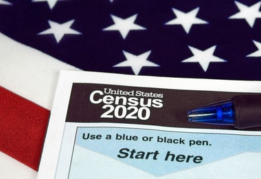 census document form and ball point ink pen on American flag for 2020