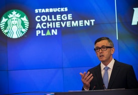 NEW YORK, NY - JUNE 17:  Cliff Burrows, group president for Starbucks in the Americas and Teavana, speaks at the opening bell of the Nasdaq Stock Exchange on June 17, 2014 in New York City. Starbucks announced a partnership with Arizona State University (ASU) yesterday, where Starbucks employees will be able to go to school online through ASU and Starbucks will pay for tuition.  (Photo by Andrew Burton/Getty Images)