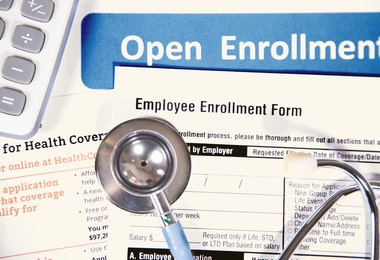 Healthcare benefit forms including: enrollment forms and applications, stethoscope, calculator.  Affordable healthcare remains an important topic around the world!