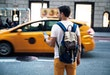Walking down the Manhattan using app for Taxi service