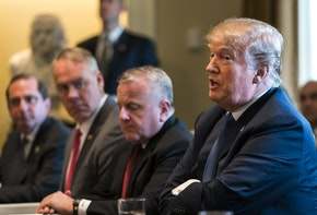 WASHINGTON, DC - APRIL 9: (AFP OUT) U.S. President Donald J. Trump (C) speaks with the media before a meeting with his cabinet in the Cabinet Room of the White House April 9, 2018 in Washington DC. Trump said he will decide in the next few days whether  the US will respond militarily for the reported chemical weapons attack in Syria. (Photo by Jim Lo Scalzo-Pool/Getty Images)