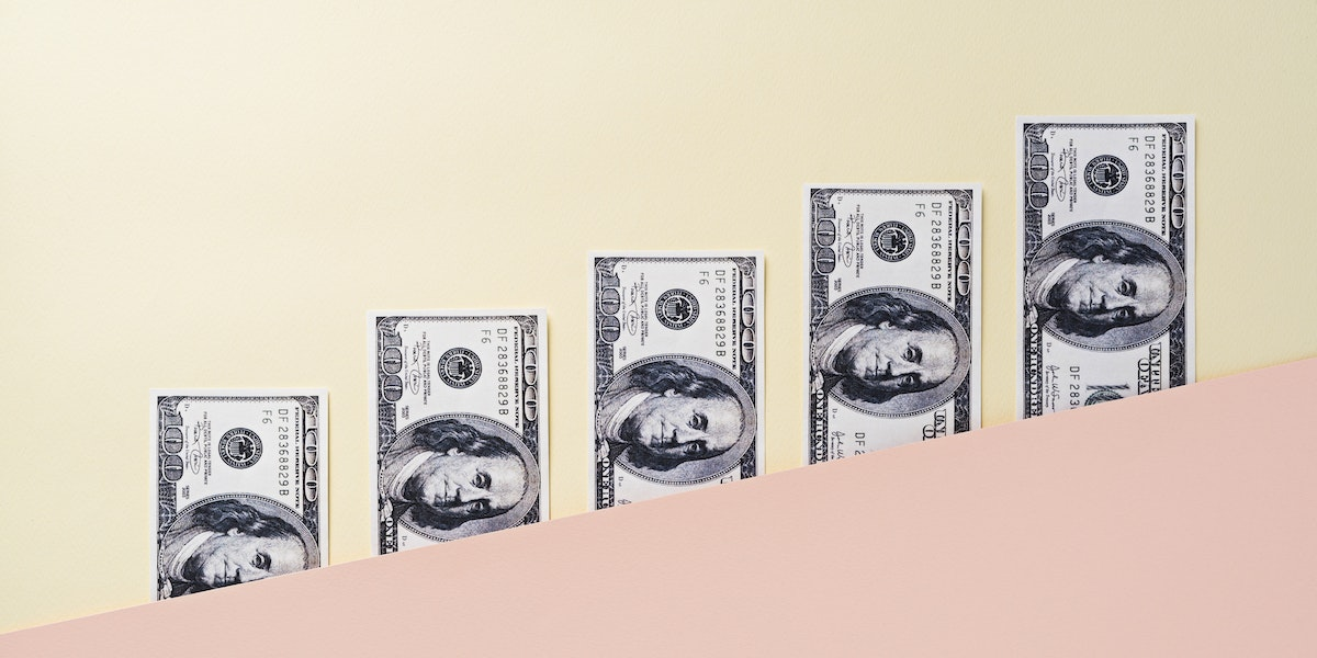 Money on pastel color block background.