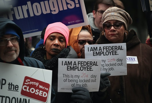 CHICAGO, ILLINOIS - JANUARY 10: Government workers protest the government shutdown during a demonstration in the Federal Building Plaza on January 10, 2019 in Chicago, Illinois. The protest, on the 20th day of a partial shutdown, was one of several held around the country today.  (Photo by Scott Olson/Getty Images)