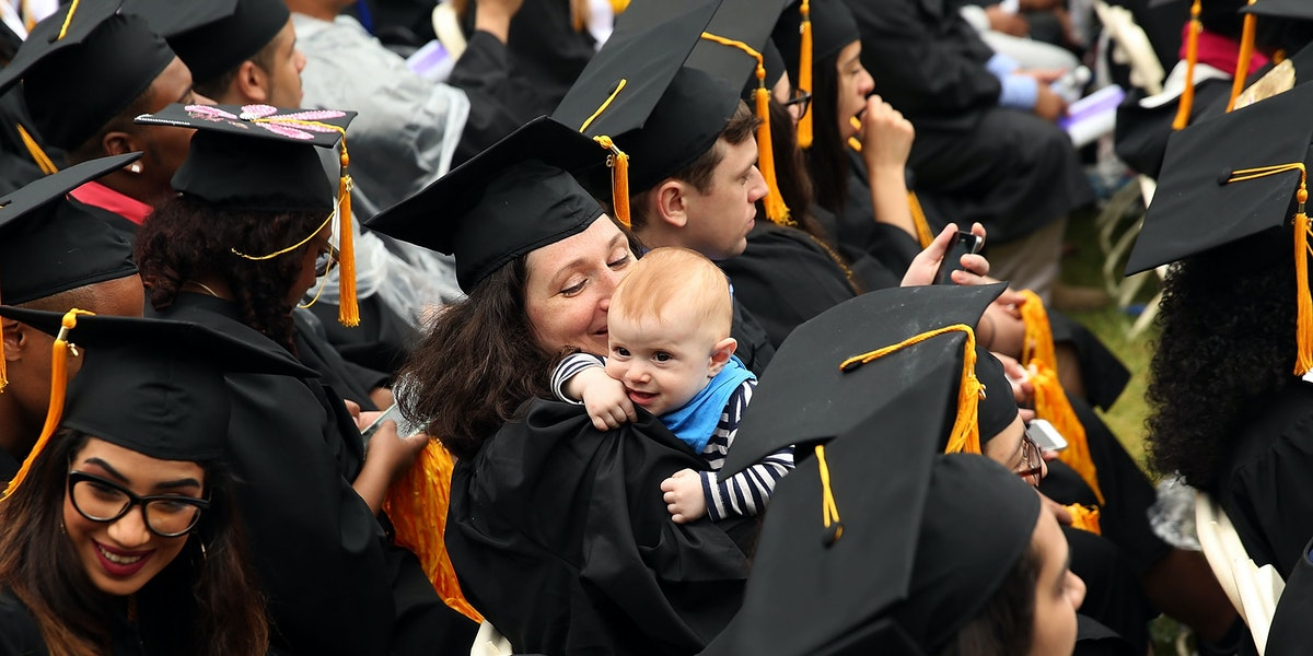 NEW YORK, NY - JUNE 03:  A graduating student holds her child as she participates in commencement exercises at City College where First lady Michelle Obama delivered the commencement speech after being presented with an honorary doctorate of humane letters at City College on June 3, 2016 in New York City. This is the final  commencement speech of her tenure as first lady. In her speech Mrs. Obama celebrated City College's diverse student body and the struggles that many students endured on the road to graduation.  (Photo by Spencer Platt/Getty Images)