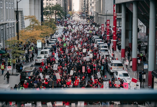 CHICAGO, IL - OCTOBER 23: Thousands of demonstrators take to the streets, stopping traffic and circling City Hall in a show support for the ongoing teachers strike on October 23, 2019 in Chicago, Illinois. Union teachers and school staff members are demanding more funding from the city in order to lower class sizes, hire more support staff, and build new affordable housing for the 16,000 Chicago Public Schools students whose families are homeless. (Photo by Scott Heins/Getty Images)