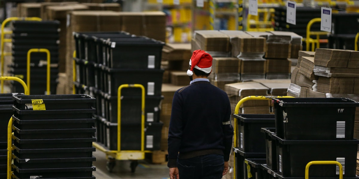 PETERBOROUGH, ENGLAND - NOVEMBER 27: (EDITORS NOTE: EMBARGOED TO 0001 ON THURSDAY NOVEMBER 28, 2019) A worker in the Peterborough Amazon Fulfilment Centre prepares for Black Friday on November 27, 2019 in Peterborough, England. The Amazon Black Friday sale runs from November 22-29, with thousands of deals on the latest consumer electronics and Amazon devices as well as this year's must-have toys, games, fashion, jewellery, beauty, home items and more. (Photo by Hollie Adams/Getty Images)