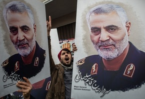 ISTANBUL, TURKEY - JANUARY 05: People hold posters showing the portrait of Iranian Revolutionary Guard Major General Qassem Soleimani and chant slogans during a protest outside the U.S. Consulate on January 05, 2020 in Istanbul, Turkey. Major General Qassem Soleimani, was killed by a U.S. drone strike outside the Baghdad Airport on January 3. Since the incident, tensions have risen across the Middle East.  (Photo by Chris McGrath/Getty Images)