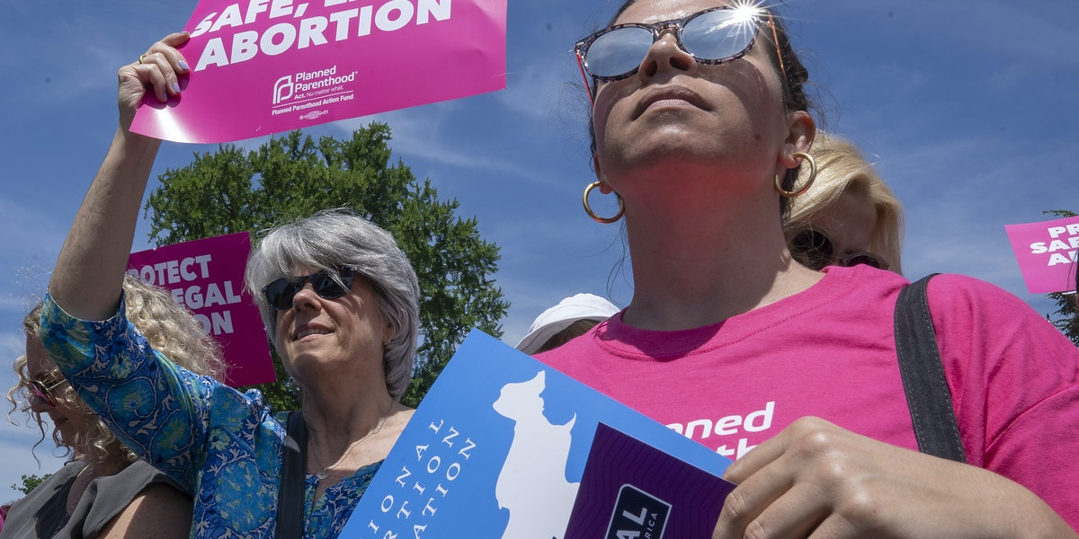WASHINGTON, DC - MAY 21: Pro-choice protesters gather at the Supreme Court on May 21, 2019 in Washington, DC. The Alabama abortion law, signed by Gov. Kay Ivey last week, includes no exceptions for cases of rape and incest, outlawing all abortions except when necessary to prevent serious health problems for the woman. Though women are exempt from criminal and civil liability, the new law punishes doctors for performing an abortion, making the procedure a Class A felony punishable by up to 99 years in prison. (Photo by Tasos Katopodis/Getty Images)