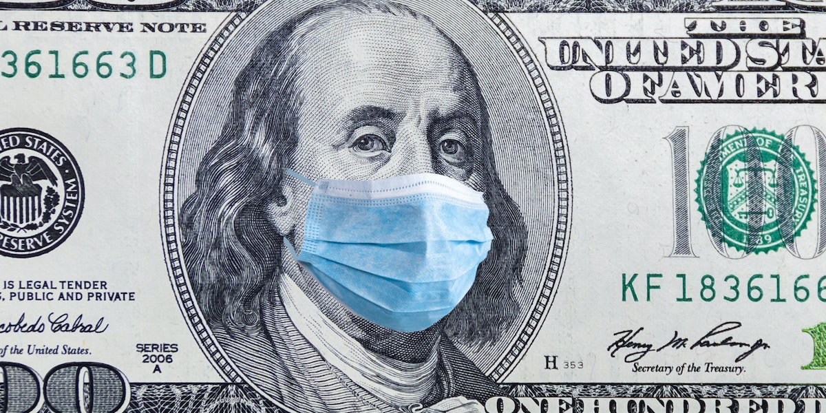 Coronavirus Wuhan. US quarantine, 100 dollar banknote with medical mask. The concept of epidemic and protection against coronavrius.