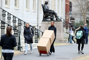 CAMBRIDGE, MASSACHUSETTS - MARCH 12: Sophomore Sadia Demby moves her belongings through Harvard Yard on the campus of Harvard University on March 12, 2020 in Cambridge, Massachusetts. Students have been asked to move out of their dorms by March 15 due to the Coronavirus (COVID-19) risk. All classes will be moved online for the rest of the spring semester.  (Photo by Maddie Meyer/Getty Images)