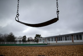 STAMFORD,  - MARCH 17: A playground swing hangs at the KT Murphy Elementary School on March 17, 2020 in Stamford, Connecticut. Stamford Public Schools closed last week to help slow the spread of the COVID-19.  (Photo by John Moore/Getty Images)