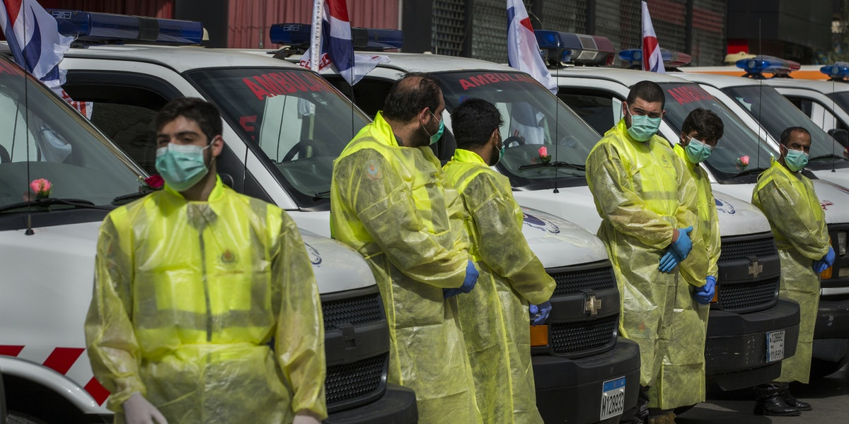 BEIRUT, LEBANON - MARCH 31: Hezbollah medical workers stand in front of ambulances during a demonstration by Hezbollah showing what the organization is doing to help in the fight against the coronavirus outbreak on March 31, 2020 in Beirut, Lebanon. Lebanon has recorded more than 400 cases of COVID-19, a handful of them fatal, and the government has imposed lockdown measure to curb the spread of the virus. (Photo by Daniel Carde/Getty Images)