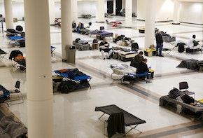 SEATTLE, WA - APRIL 06: The Exhibition Hall at the Seattle Center has been turned into a temporary men's shelter on April 6, 2020 in Seattle, Washington. The space currently has 150 beds, separated six feet apart, and operated by the Downtown Emergency Service Center (DESC). King County and the City of Seattle are working with higher capacity shelters to create more spaces and increase social distancing between individuals, which can help prevent the spread of COVID-19.  (Photo by Karen Ducey/Getty Images)