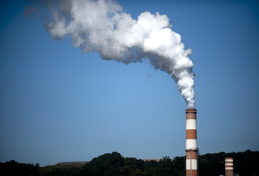 NEW EAGLE, PA - SEPTEMBER 24: A plume of exhaust extends from the Mitchell Power Station, a coal-fired power plant built along the Monongahela River, 20 miles southwest of Pittsburgh, on September 24, 2013 in New Eagle, Pennsylvania. The plant, owned by FirstEnergy, will be one of two plants in the region to be shut down, affecting 380 employees.  The Evironmental Protection Agency (EPA) and the Obama administration have been taking major steps to get coal-fired power plants into compliance with clean air regulations. (Photo by Jeff Swensen/Getty Images)