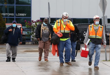 WARREN, MICHIGAN - MAY 18: United Auto Workers members leave the Fiat Chrysler Automobiles Warren Truck Plant after the first work shift on May 18, 2020 in Warren, Michigan. Fiat Chrysler along with rivals Ford and General Motors Co., restarted the assembly lines on Monday after several week of inactivity due to the COVID-19 pandemic. (Photo by Gregory Shamus/Getty Images)
