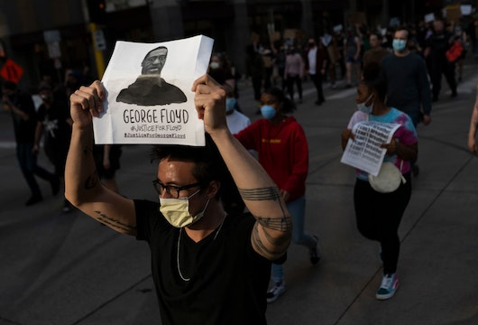 MINNEAPOLIS, MN - MAY 28: Protesters march through the street on May 28, 2020 in downtown Minneapolis, Minnesota. Police and protesters continued to clash for a third night after George Floyd was killed in police custody on Monday. (Photo by Stephen Maturen/Getty Images)