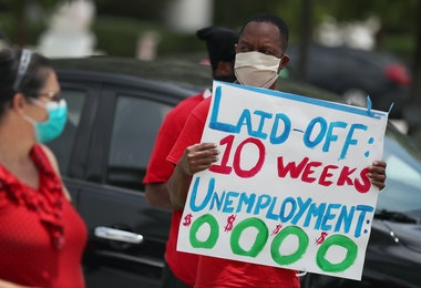 MIAMI BEACH, FLORIDA - MAY 22: Joseph Louis joins others in a protest asking the state of Florida to fix its unemployment system on May 22, 2020 in Miami Beach, Florida. Unemployed hospitality and service workers who have not received unemployment checks held the protest demanding Florida Governor Ron DeSantis fix the unemployment system and send out their benefits. Since the closure of all non-essential businesses due to the coronavirus pandemic, hundreds of thousands of hospitality workers across Florida find themselves out of work. Florida's unemployment system has not worked reliably. (Photo by Joe Raedle/Getty Images)