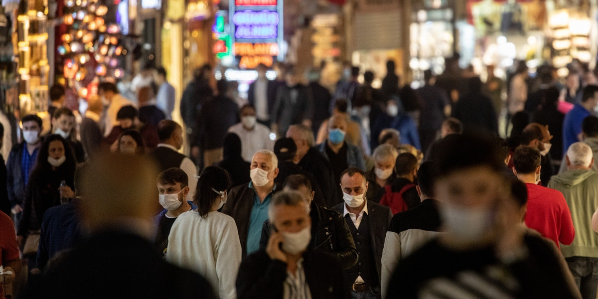 ISTANBUL, TURKEY - JUNE 01: People wearing protective face masks walk in the Grand Bazaar after it reopened after being shut down for weeks due to the spread of the coronavirus on June 01, 2020 in Istanbul, Turkey. As infection rates of the coronavirus continue to drop and after more than a month of weekend lockdowns, Turkey has begun reopening procedures, allowing bars, restaurants and cafes to open under new restrictions for the first time since March 17. Limited domestic flights have restarted and the stay-at-home curfew for citizens under 20 and over 65 has been eased.   (Photo by Chris McGrath/Getty Images)