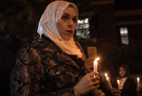 ISTANBUL, TURKEY - OCTOBER 25:  A woman takes part in a candle light vigil to remember journalist Jamal Khashoggi outside the Saudi Arabia consulate on October 25, 2018 in Istanbul, Turkey. Jamal Khashoggi, a U.S. resident and critic of the Saudi regime, went missing after entering the Saudi Arabian consulate in Istanbul on October 2. More than two weeks later Riyadh announced he had been killed accidentally during an altercation with Saudi consulate officials, however as investigations continue new information surfaced, pointing to a brutal and planned murder contradicting previous claims.  (Photo by Chris McGrath/Getty Images)