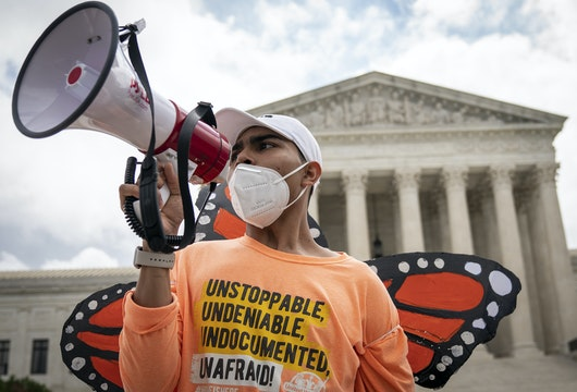 WASHINGTON, DC - JUNE 18: Roberto Martinez, a DACA recipient, chants and cheers following the Supreme Court's decision regarding the Trump administration's attempt to end DACA outside the U.S. Supreme Court on June 18, 2020 in Washington, DC. On Thursday morning, the Supreme Court, in a 5-4 decision, denied the Trump administration's attempt to end DACA, the Deferred Action for Childhood Arrivals program. (Photo by Drew Angerer/Getty Images)