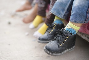 Children feet barefoot and with shoes