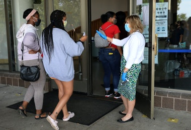 FRANKFORT, KY - JUNE 19: Unemployed Kentucky residents enter the Kentucky Career Center for help with their unemployment claims as hundred more wait in long lines outside for help with their unemployment claims on June 19, 2020 in Frankfort, Kentucky. (Photo by John Sommers II/Getty Images)
