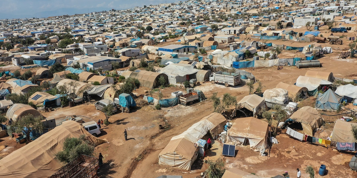"ATMEH, SYRIA - SEPTEMBER 17: A general view of the village of Atmeh which hosts nearly 1 million displaced Syrians near the Syrian-Turkish border in Idlib Province September 17, 2019 in Atmeh, Syria. Turkey's president, Recep Tayyip Erdogan, is pushing for the creation of an expanded ""safe zone"" in northern Syria where his government hopes to resettle up to three million Syrian refugees. The United States and Turkey recently started joint patrols of a small buffer zone along the border, but it's a far cry from the 20-by-300 mile strip proposed by Mr. Erdogan, and no other power involved in the war as agreed to the idea. Turkey has warned that, if it doesn't receive more international support for the safe zone, it might relax its migration controls and reopen the route for refugees to enter Europe. More than 3.6 million Syrian refugees have settled in Turkey after fleeing the civil war that began in 2011. (Photo by Burak Kara/Getty Images)"