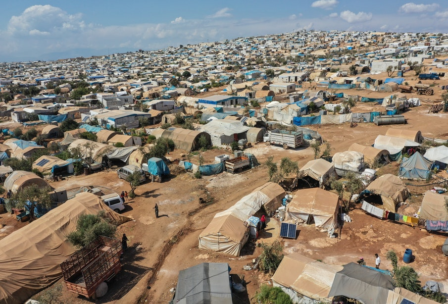 """ATMEH, SYRIA - SEPTEMBER 17: A general view of the village of Atmeh which hosts nearly 1 million displaced Syrians near the Syrian-Turkish border in Idlib Province September 17, 2019 in Atmeh, Syria. Turkey's president, Recep Tayyip Erdogan, is pushing for the creation of an expanded """"safe zone"""" in northern Syria where his government hopes to resettle up to three million Syrian refugees. The United States and Turkey recently started joint patrols of a small buffer zone along the border, but it's a far cry from the 20-by-300 mile strip proposed by Mr. Erdogan, and no other power involved in the war as agreed to the idea. Turkey has warned that, if it doesn't receive more international support for the safe zone, it might relax its migration controls and reopen the route for refugees to enter Europe. More than 3.6 million Syrian refugees have settled in Turkey after fleeing the civil war that began in 2011. (Photo by Burak Kara/Getty Images)"""